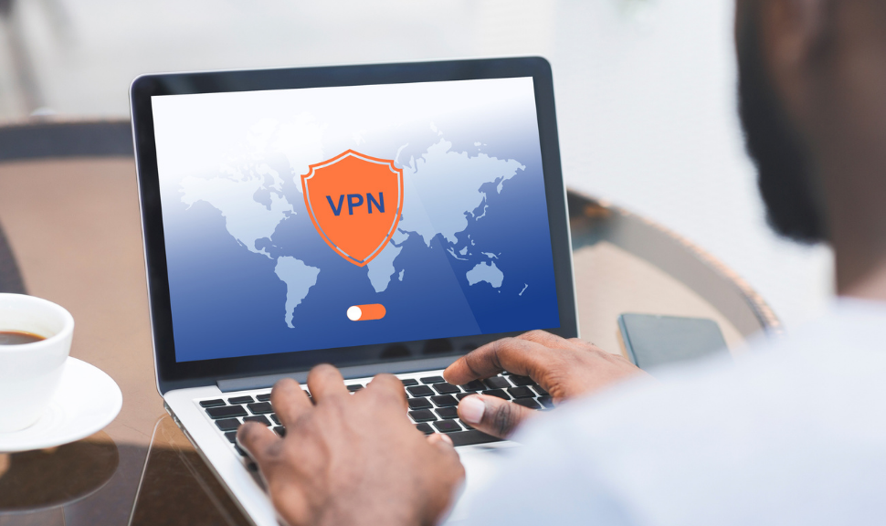 Man Using Laptop Computer With VPN Virtual Private Network Connection For cybersecurity